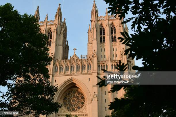 The National Cathedral with its two west towers and west rose window is seen in Washington DC June 20 2017 The official name of the Washington...