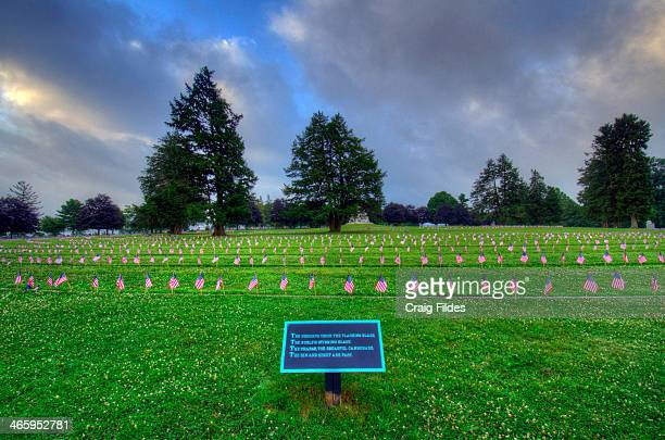 CONTENT] The National Cemetery in Gettysburg photographed with US flags the 150th Anniversary of the Civil War Battle of Gettysburg and Independence...
