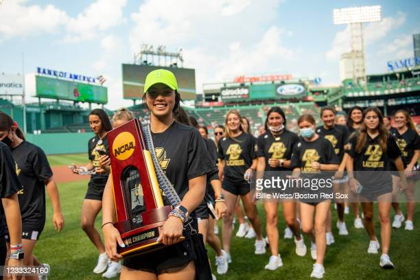 The National Champion Boston College womens lacrosse team exits the field after throwing out a ceremonial first pitch during a pre-game ceremony...