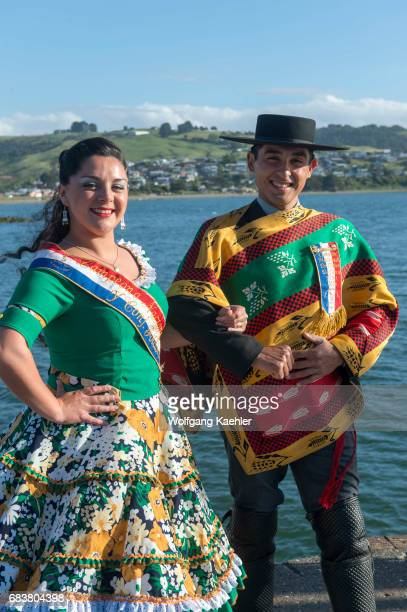 The National Champions in the Cueca dance in traditional costumes at the port of Ancud on Chiloe Island Chile