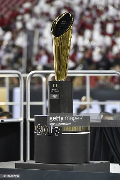The National Championship trophy is on display during the award ceremony of the CFP National Championship game between the Alabama Crimson Tide and...