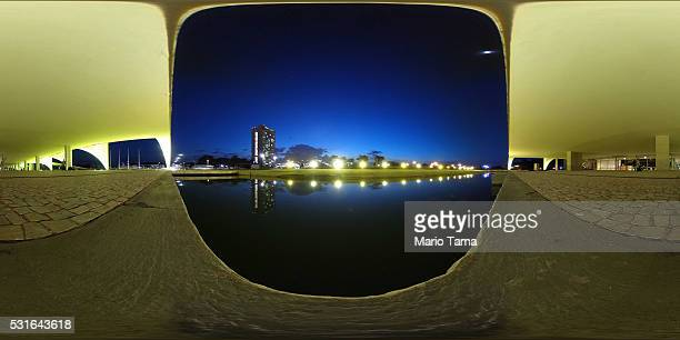 The National Congress building is reflected in a reflecting pool as seen from the Planalto presidential palace on May 13, 2016 in Brasilia, Brazil....