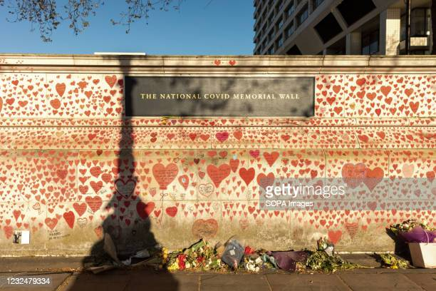 The National COVID Memorial Wall is established along the banks of River Thames, outside St. Thomas' Hospital in London to commemorate NHS staff and...