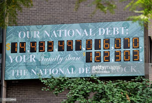 The National Debt Clock a billboardsize digital display showing the increasing US debt on Sixth Avenue August 1 2011 in New York US Vice President...