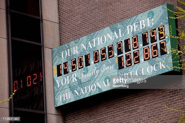 The National Debt Clock is displayed on a building in New York US on Tuesday April 19 2011 US President Barack Obama said today at a town hall...