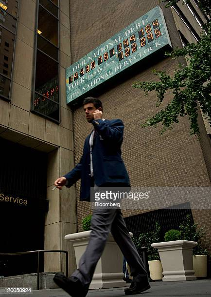 The National Debt Clock is displayed on the side of a building in New York US on Friday July 29 2011 House Republican leaders four days before a...