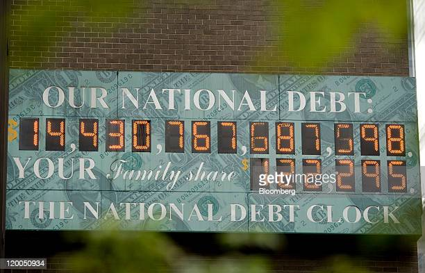 'The National Debt Clock ' is displayed on the side of a building in New York US on Friday July 29 2011 House Republican leaders four days before a...