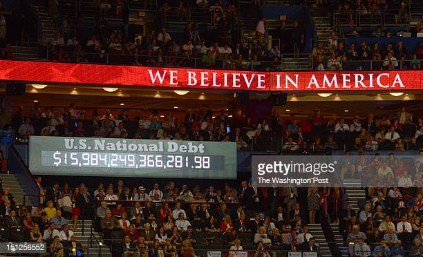 The national debt clock runs during the final day of the 2012 Republican National Convention at the Tampa Bay Times Forum on August 30 2012 in Tampa...