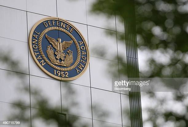 The National Defense Academy of Japan logo is displayed on a building at the NDA campus in Yokosuka Kanagawa Prefecture Japan on Monday April 21 2014...