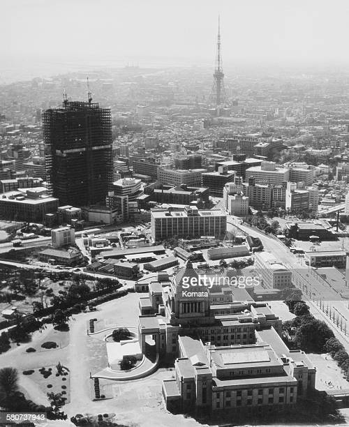 The National Diet Building in Tokyo Japan circa 1966 The Kasumigaseki Building then the tallest building in Tokyo is under construction in the centre...