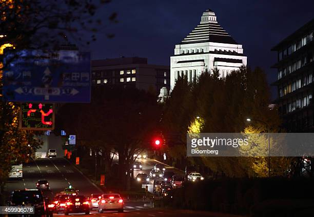 The National Diet building stands illuminated at night in Tokyo, Japan, on Wednesday, Dec. 3, 2014. Prime Minister Shinzo Abe took his economic...