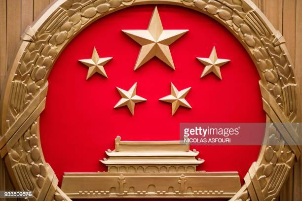 The National emblem of the People's Republic of China is seen during the sixth plenary session of the first session of the 13th National People's...