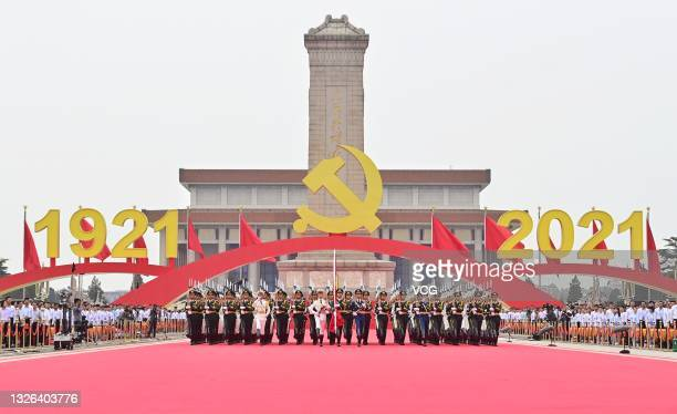 The national flag guards march during a flag-raising ceremony at a grand gathering celebrating the centenary of the Communist Party of China at...