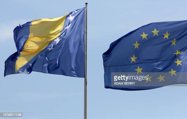 The national flag of Bosnia and Herzegovina is pictured next to the European Union flag during a welcoming ceremony for Bosnia's Chairman of the...