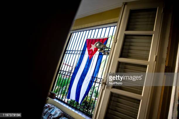 The national flag of Cuba is seen in a Casa Particulares in Vedado Cuba on January 15 2020 The city attracts milions of tourists annually Old Havana...