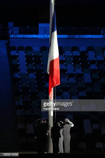 The national flag of France is raised during the Closing Ceremony of the Tokyo 2020 Olympic Games at Olympic Stadium on August 08, 2021 in Tokyo,...