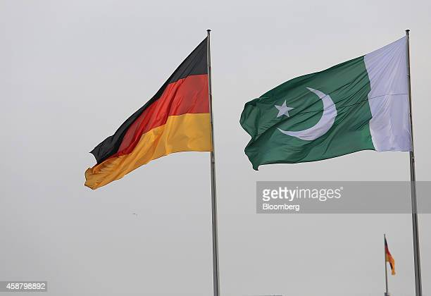 The national flag of Germany left and the national flag of Pakistan fly above the Chancellery in Berlin Germany on Tuesday Nov 11 2014 Angela Merkel...