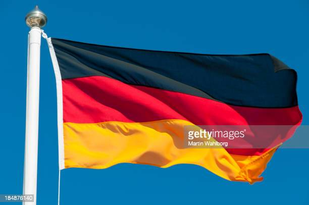 the national flag of germany waving in the wind - german flag stock pictures, royalty-free photos & images