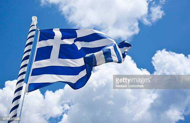 The national flag of greece in blue and white in front of blue sky on June 29 2015 in Mykonos Greece