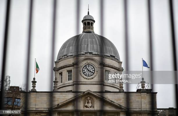 The national flag of Ireland and the European Union flag fly atop Government Buildings in Dublin on February 7 on the eve of the country's General...