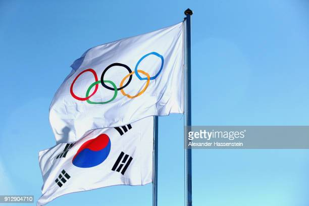 The national flag of Korea is pictured with the Olympic flag during the PyeongChang 2018 Olympic Village opening ceremony at the PyeongChang 2018...