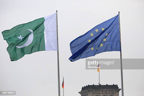 The national flag of Pakistan left and the European Union flag fly above the Chancellery in Berlin Germany on Tuesday Nov 11 2014 Angela Merkel...