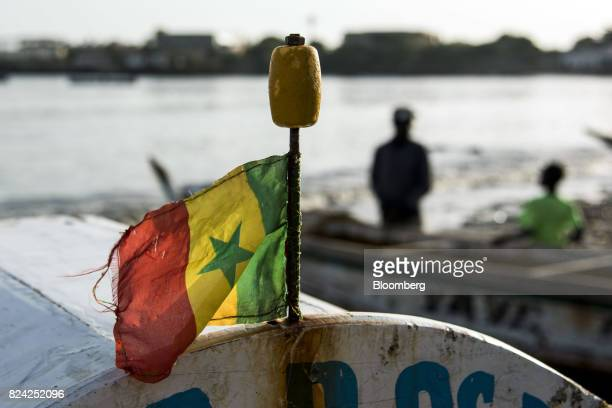 The national flag of Senegal flies on a fishing boat at the Soumbedioune fish market in Dakar Senegal on Friday July 28 2017 Senegalese voters will...