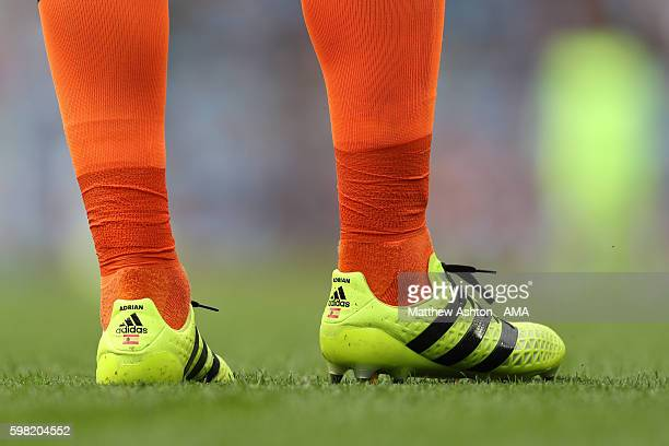 The national flag of Spain on the Adidas football boots of goalkeeper Adrian San Miguel del Castillo of West Ham United during the Premier League...