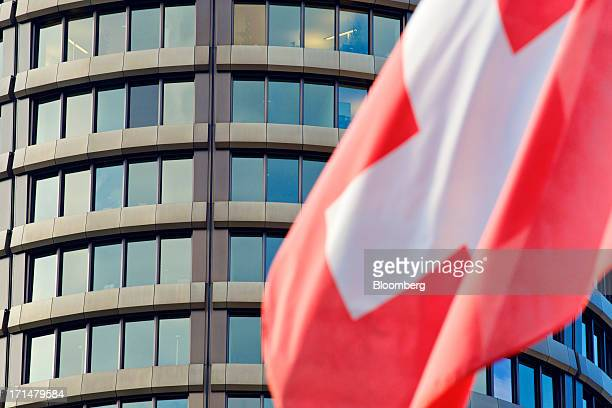 The national flag of Switzerland flies outside the headquarters of the Bank for International Settlements in Basel Switzerland on Tuesday June 25...