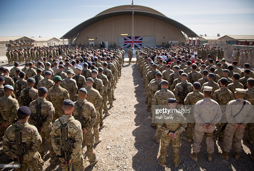 The national flag of the United Kingdom is displayed as British troops and service personal remaining in Afghanistan are joined by International Security Assistance Force (ISAF) personnel and civilians as they gather for a Remembrance Sunday service at Kandahar Airfield November 9, 2014 in Kandahar, Afghanistan. As the UK combat mission in Afghanistan draws to an end in 2014 this year, which also marks the 100th anniversary of the start of World War One, 70 years since the D-Day landings will be the last time British service personal will gather in any great numbers in the south of the country.