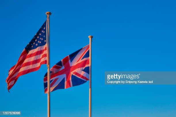 the national flag of the united states of america and the united kingdom. - diplomacy stock pictures, royalty-free photos & images
