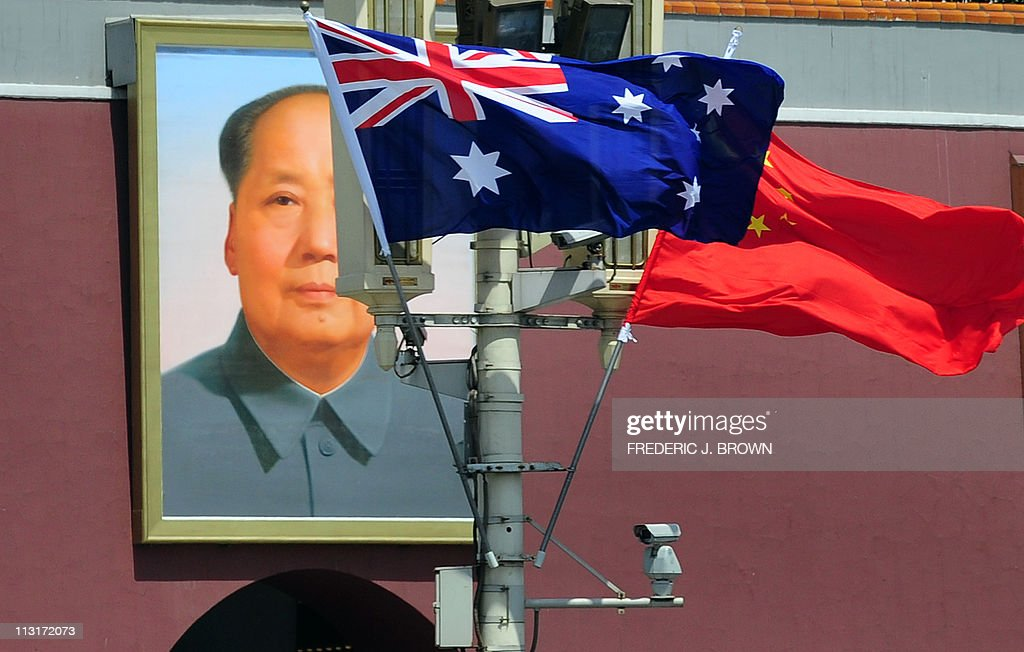 The national flags of Australia and Chin : News Photo