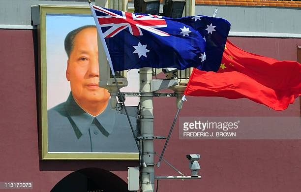 The national flags of Australia and China are displayed before a portrait of Mao Zedong facing Tiananmen Square during a visit by Australia's Prime...