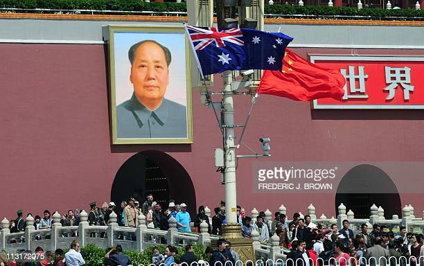 The national flags of Australia and China are displayed before a portrait of Mao Zedong facing Tiananmen Square, during a visit by Australia's Prime...