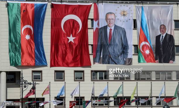The national flags of Azerbaijan and Turkey, and portraits of Turkish President Recep Tayyip Erdogan and Azerbaijani President Ilham Aliyev hang...
