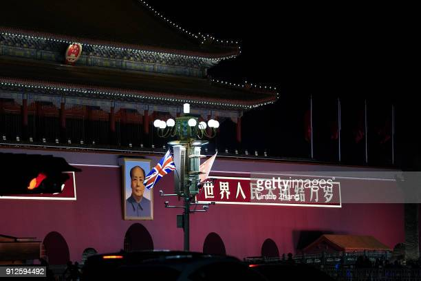 The national flags of Britain and China fly outside the Forbidden City after a welcome ceremony for British Prime Minister Theresa May on January 31,...