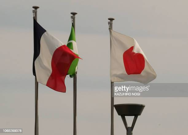 The national flags of France and Japan are displayed at an entrance of Japan's Nissan Motor's Oppama plant in Yokosuka Kanagawa prefecture on...