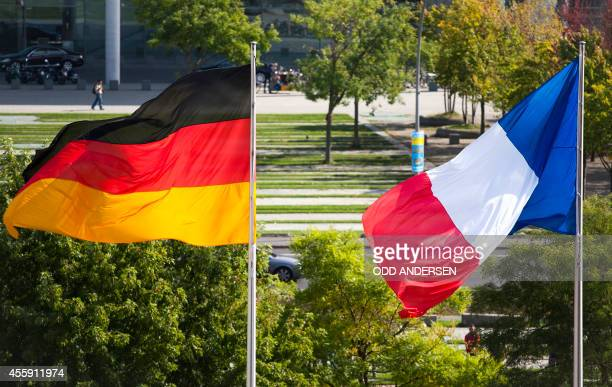 The national flags of Germany and France are seen at the Chancellery in Berlin on September 22 2014 as German Chancellor welcomes French Prime...