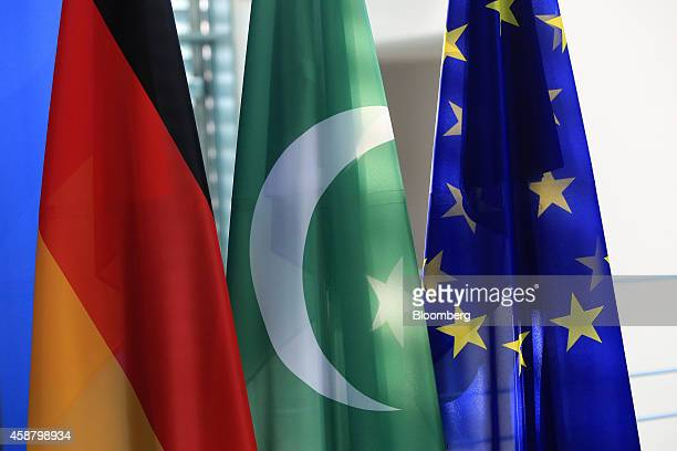 The national flags of Germany left and Pakistan center hang next to the European Union flag in the Chancellery in Berlin Germany on Tuesday Nov 11...