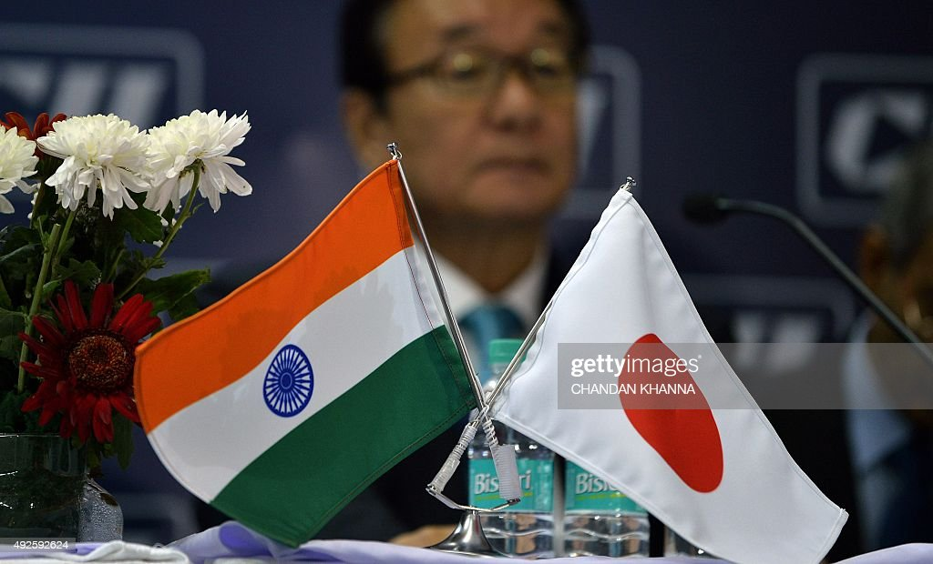 The national flags of India and Japan are seen during a press confrence at the 11th International Railway Equipment Exhibition, 2015 in New Delhi on October 14, 2015. AFP PHOTO / Chandan KHANNA