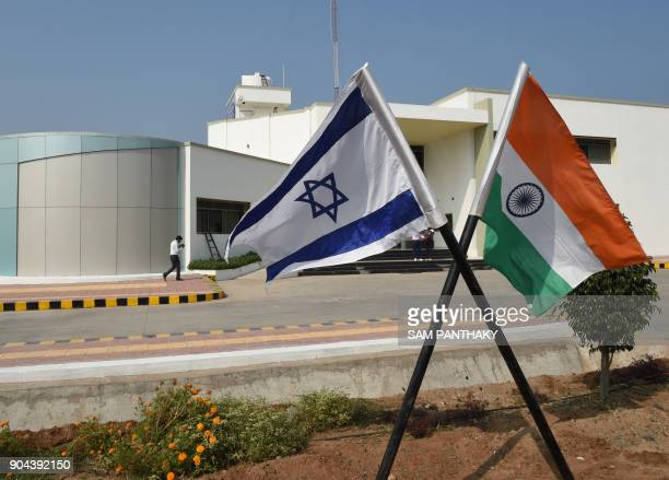 The national flags of Israel and India stand in the campus of the Centre of Excellence for Vegetables at Vadrad village some 70 kms from Ahmedabad on...