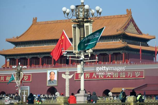 The national flags of Saudi Arabia and China are displayed from a road lamp at Tiananmen square in Beijing on February 21 2019 Saudi Crown Prince...