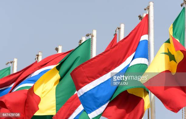 The national flags of Senegal and Gambia are pictured at Dakar airport within the arrival of Gambia's new president for his first state visit in...