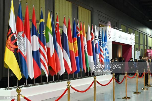 The national flags of the various countries attending the 35th Association of Southeast Asian Nations Summit are displayed in Bangkok on November 4,...