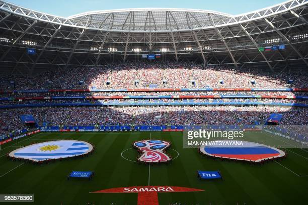 The national flags of Uruguay and Russia are seen on the pitch before kick off of the Russia 2018 World Cup Group A football match between Uruguay...