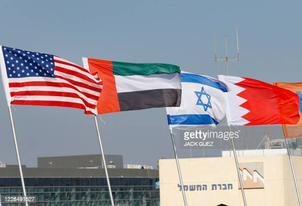 The national flags of US United Arab Emirates Israel and Bahrain are flown along a road in the resort city of Netanya in central Israel on September...
