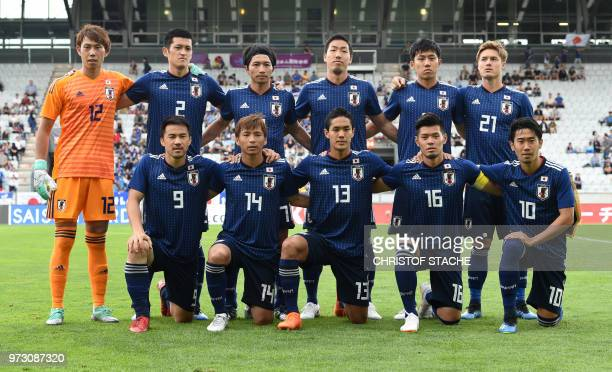 The national football team of Japan poses for a group photo prior to the international friendly football match between Japan and Paraguay in...