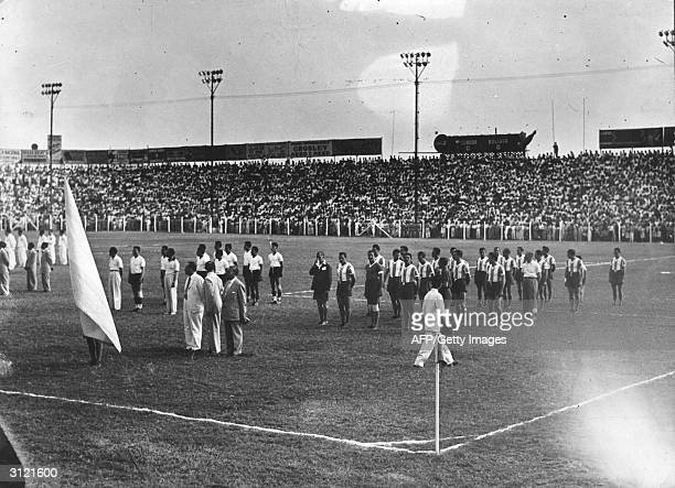 The national football teams of Argentina and Ecuador sing their respective national anthems during the 1947 South American Championship