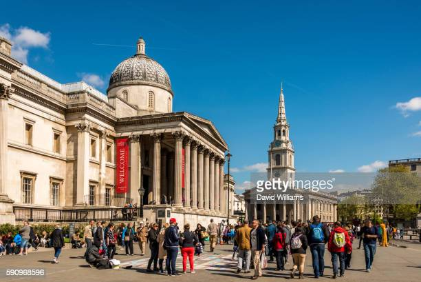 The National Gallery and St Martin in the Fields Church on Trafalgar Square, London, England.