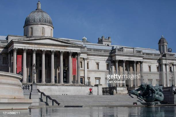 The National Gallery closed and an empty Trafalgar Square on March 24 2020 in London England British Prime Minister Boris Johnson announced strict...